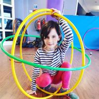 Girl with hula hoops