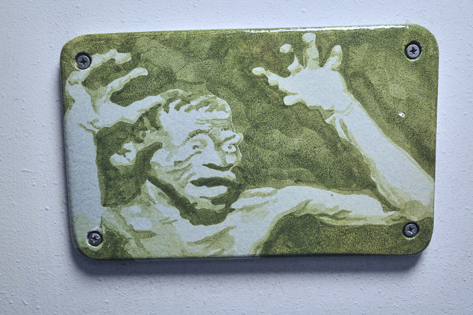 Plaque, screaming figure