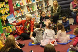 Volunteer Margaret reading with the Little Legends