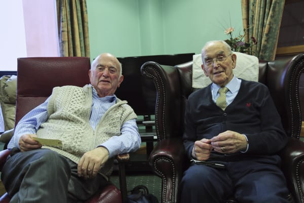 Two older men at Reading Friends session